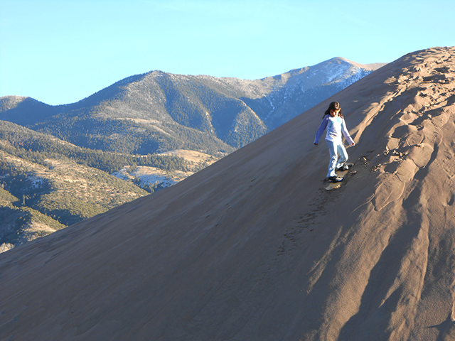 Great Sand Dunes girl sandboarding